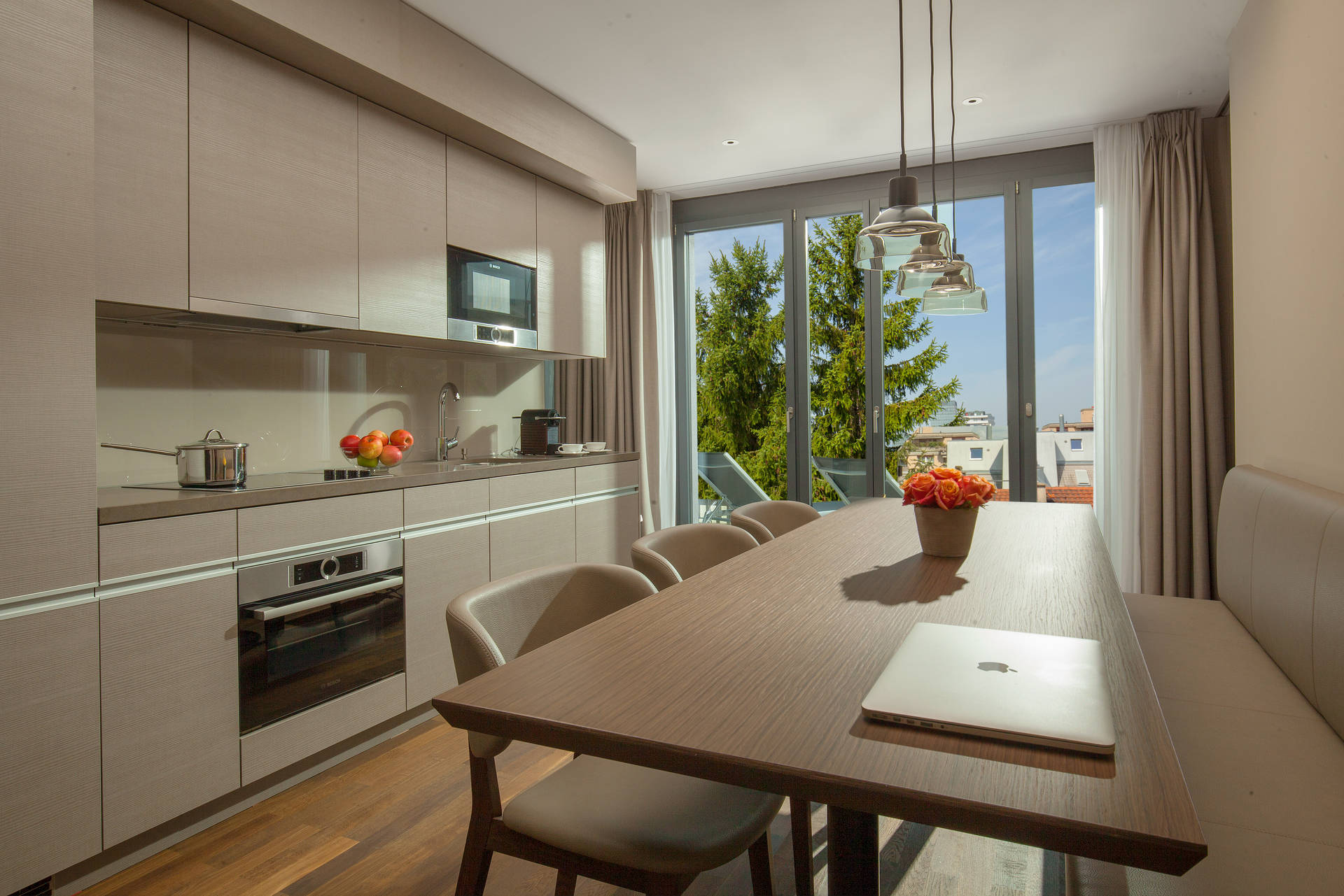 Kitchen with access to roof terrace in the Rooftop Suite in ACASA Suites Zurich