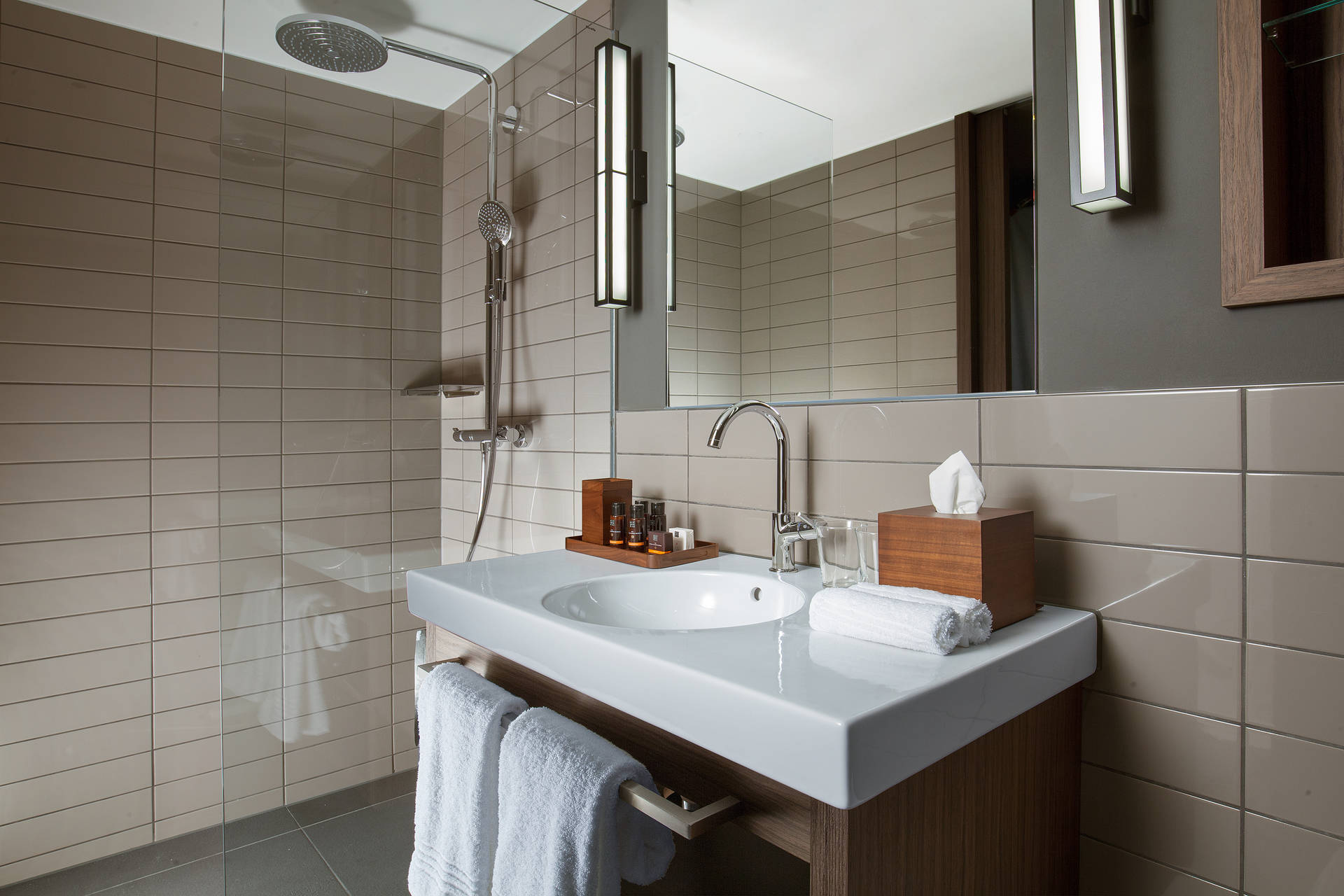 Bathroom with rain shower in ACASA Suites Zurich